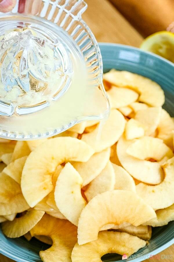Lemon juice poured over apple slices.