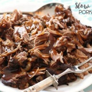 Slow Cooker Pork Roast on a plate with a fork.