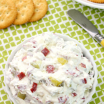 Dill Pickle Wrap Dip in a white bowl with crackers.