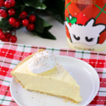 No-Bake Eggnog Pie on a white plate with a bottle of eggnog.