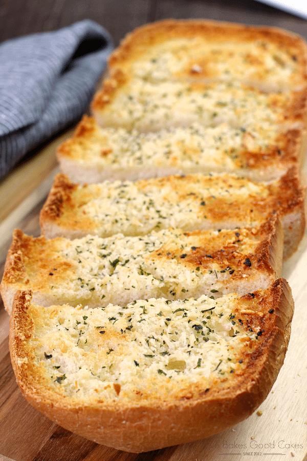 BEST Garlic Bread sliced on a cutting board.