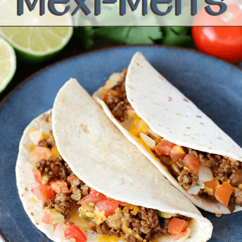 Homemade Mexi-Melts on a blue plate with fresh vegetables behind it.