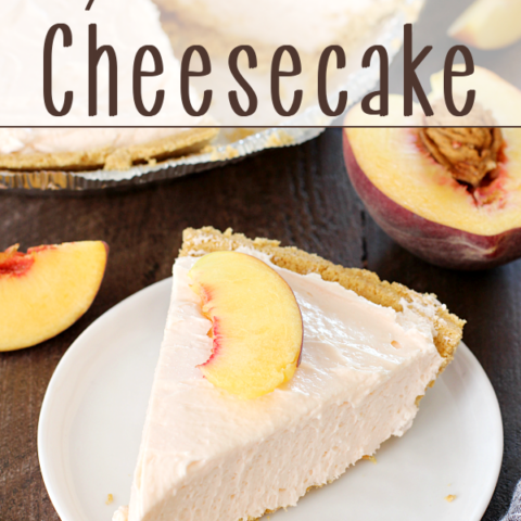 No-Bake Peach Cheesecake on a white plate with a peach sliced in half.