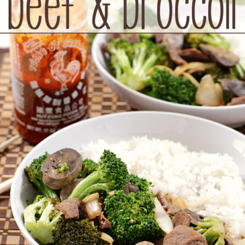 Slow Cooker Beef & Broccoli on white plates with rice.