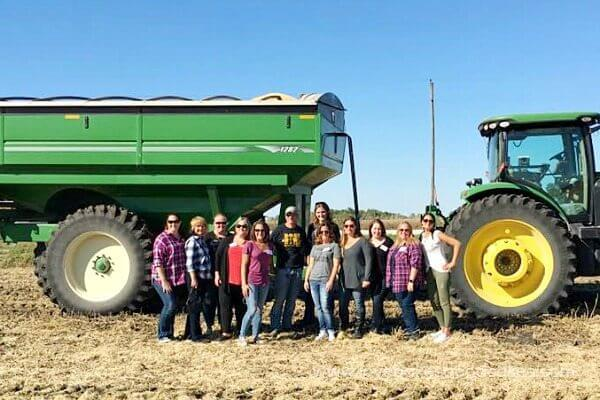 bloggers in front of farm equipment #IACornQuest