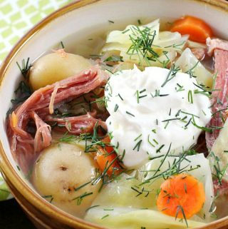 Leftover corned beef gets new life in this Corned Beef and Cabbage Soup. Corned Beef, cabbage, carrots, and potatoes mix for a new spin on the traditional St. Patricks' Day meal!