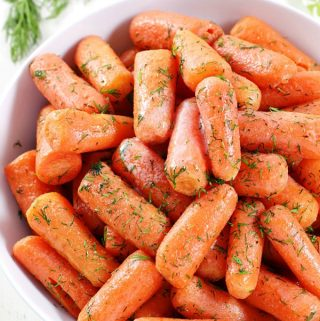 Take carrots to the next level with this Dill Butter Carrots recipe. Tender, sweet carrots pair perfectly with butter and dill in this quick and easy side dish.