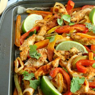Get dinner on the table quickly with this Sheet Pan Chicken Fajitas recipe! Tender strips of chicken, bell pepper, and onion mingle in a tantalizing array of Mexican flavors. Serve with your favorite garnishments and (an optional) Margarita!