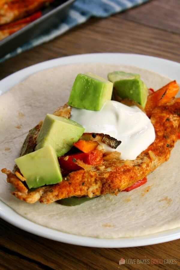 Sheet Pan Chicken Fajitas on a flour tortilla.