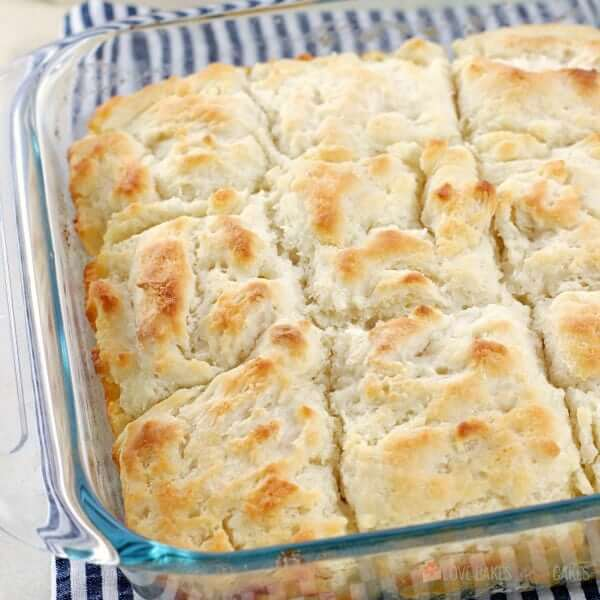 Butter Dip Biscuits sliced in a baking dish.