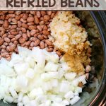 This Slow Cooker Refried Beans recipe is so easy to make! It's the perfect addition to -or side dish for - all of your Mexican dishes.