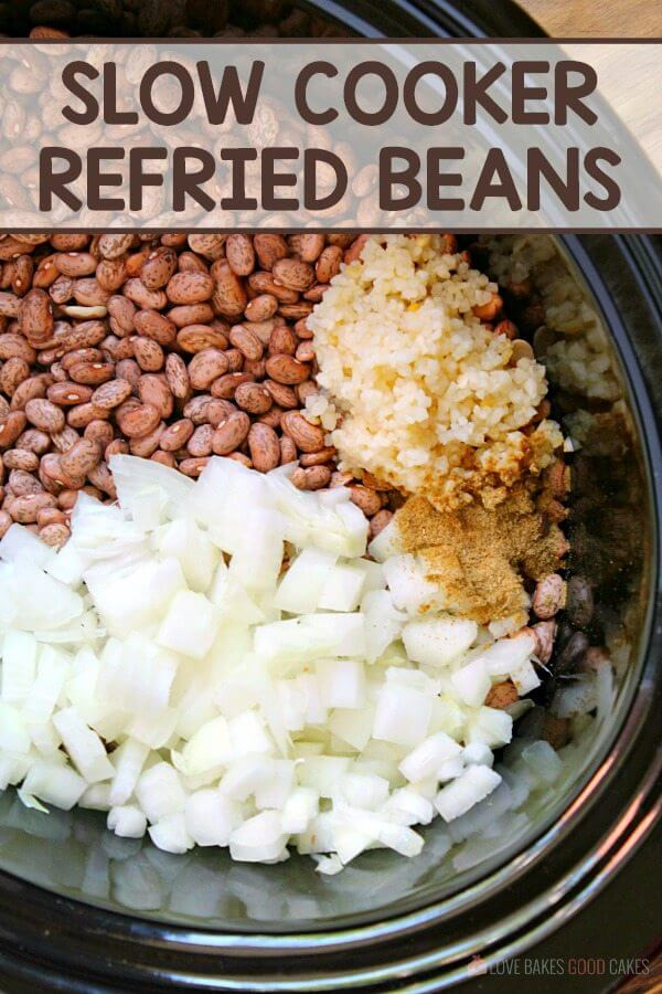Slow cooker refried bean ingredients in a slow cooker.