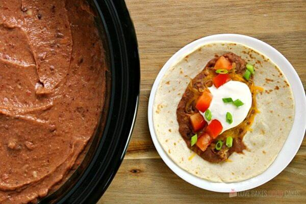 This Slow Cooker Refried Beans recipe is so easy to make! It's the perfect addition to -or side dish - for all of your Mexican dishes.