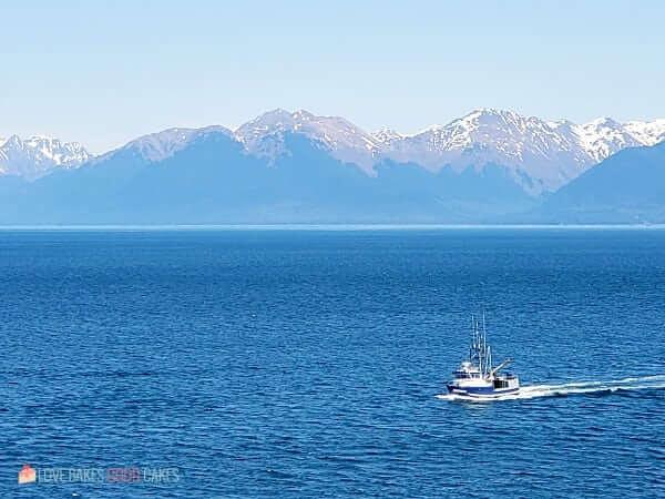 A pilot boat making its way to a cruise ship.