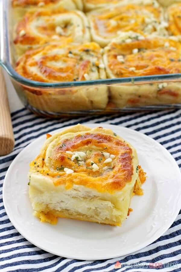 "Cheesy Garlic Bread ""Cinnamon"" Roll in a casserole dish and on a plate."