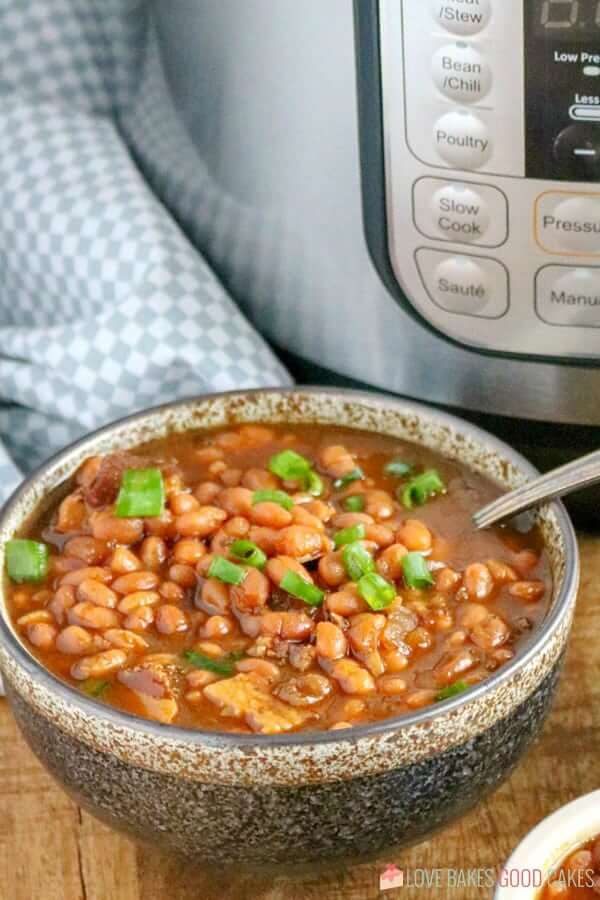 Instant Pot Baked Beans in a bowl with a spoon.