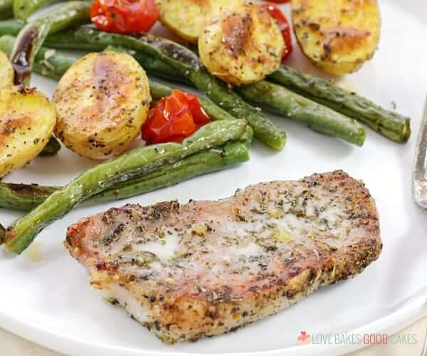 When you need to make mealtime quick and easy, give this Italian Pork Chop Sheet Pan Dinner a try! Italian-spiced Pork Chops bake with potatoes, green beans, and tomatoes for a supper everyone will love!
