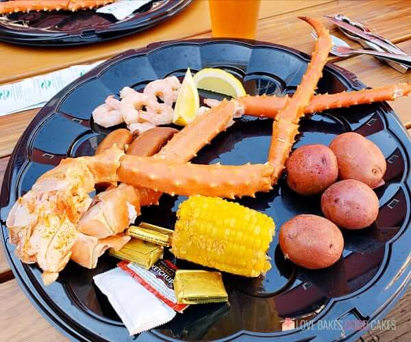 Seafood Feast on a plate with crab legs, corn on the cob, russet potatoes and shrimp.