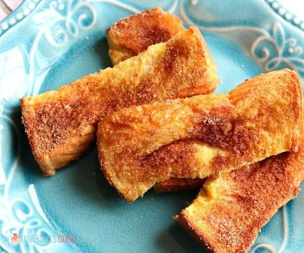 These Air Fryer French Toast Sticks are so quick and easy to make. Make them ahead, freeze, and just reheat to make busy mornings fuss-free!