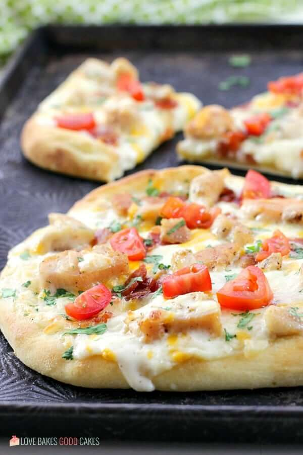 Chicken Bacon Ranch Naan Bread Pizza close up on a baking sheet.