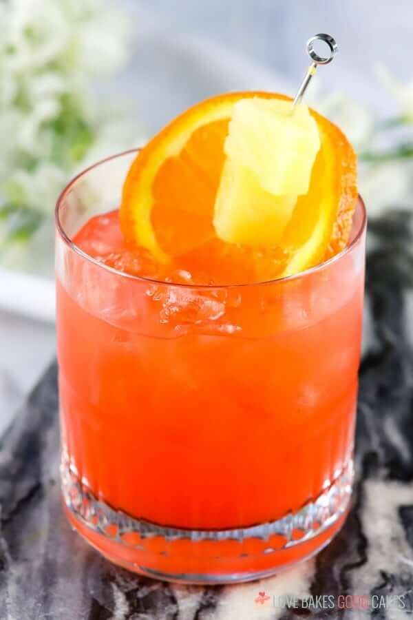 This Orange and Pineapple Rum Punch is the perfect adults-only refreshment on a hot summer day! Let the tropical flavors melt the stress away!