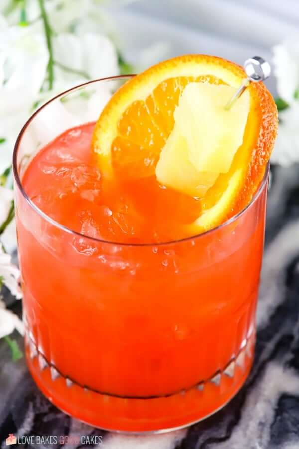Orange and Pineapple Rum Punch in a glass close up.
