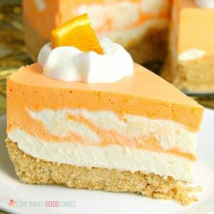 This No-Bake Orange Creamsicle Cheesecake is a nostalgic bite of bright orange and creamy vanilla, reminiscent of those long-gone summer days of your childhood.