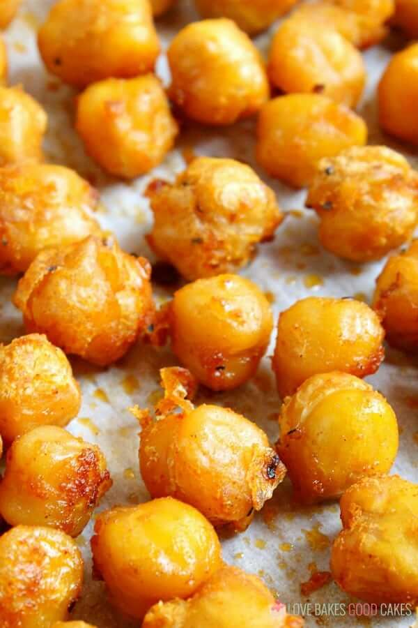 Spicy Roasted Chickpeas close up on a baking sheet.