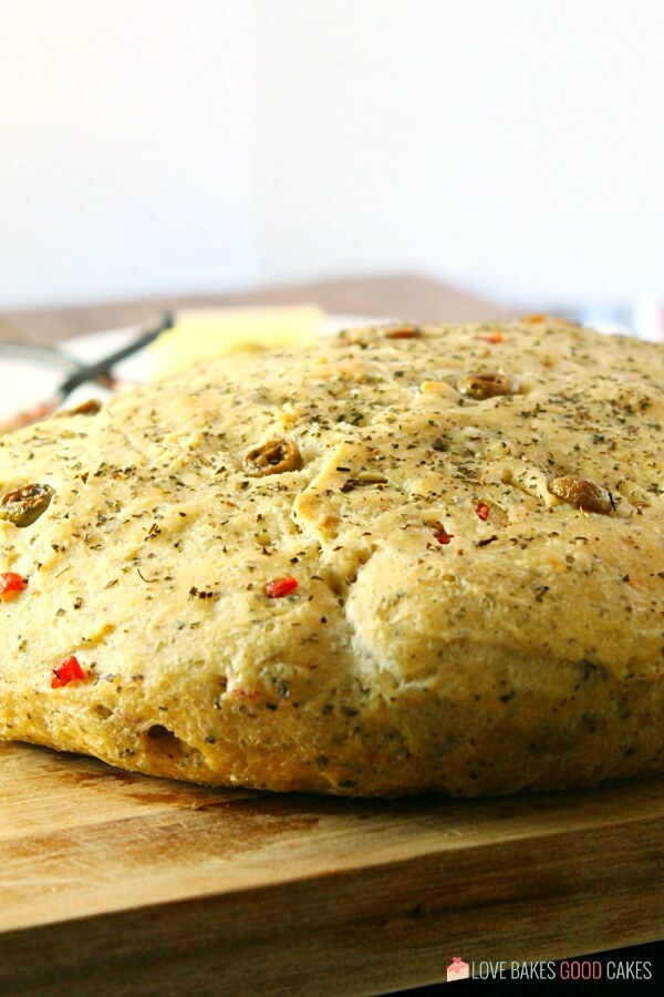 No-Knead Skillet Olive Bread! It's a super easy to make, crusty, homemade bread packed with olives and herbs