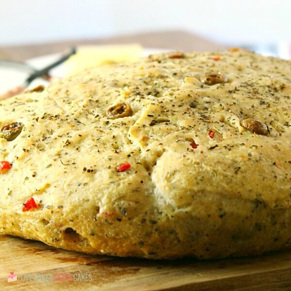 No-Knead Skillet Olive Bread! It's a super easy to make, crusty, homemade bread packed with olives and herbs.