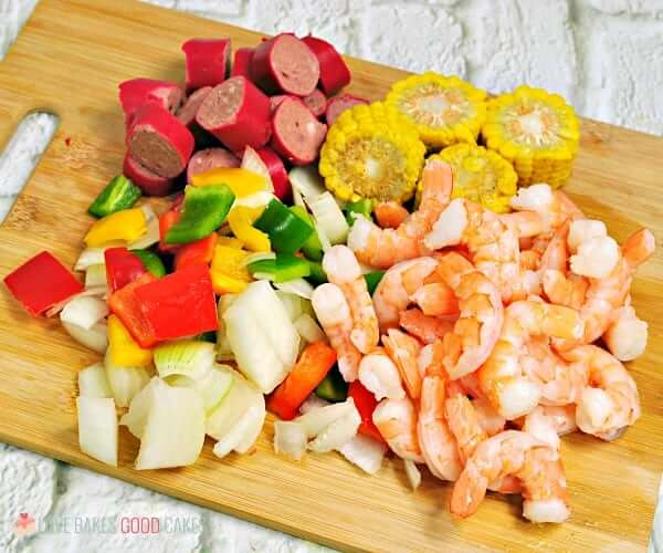 Spice up dinner with these Shrimp Boil Foil Packets! Bake or grill this easy mix of corn, sausage, shrimp, onions, and bell peppers with a zesty Cajun seasoning mix.