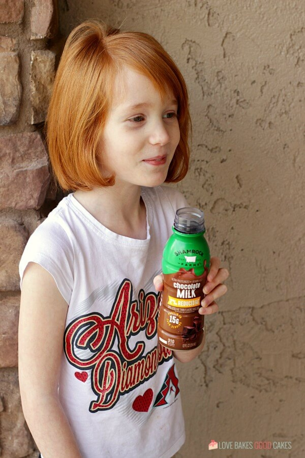 girl with a Shamrock Farms milk container