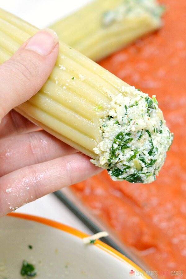 Manicotti shells stuffed with spinach ricotta cheese mixture