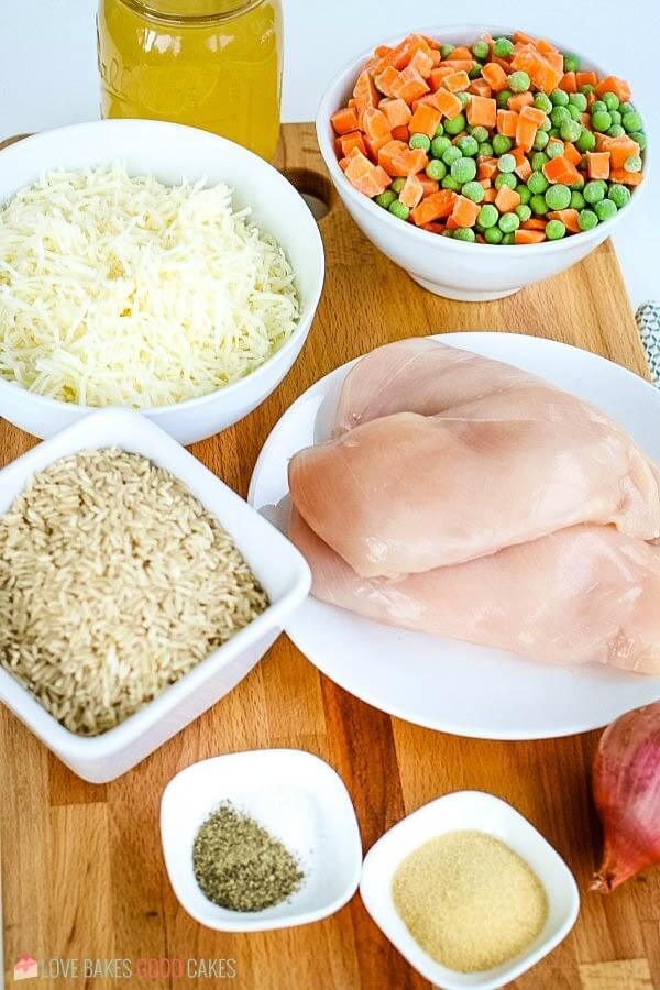 Ingredients to make a slow cooker chicken and rice recipe.