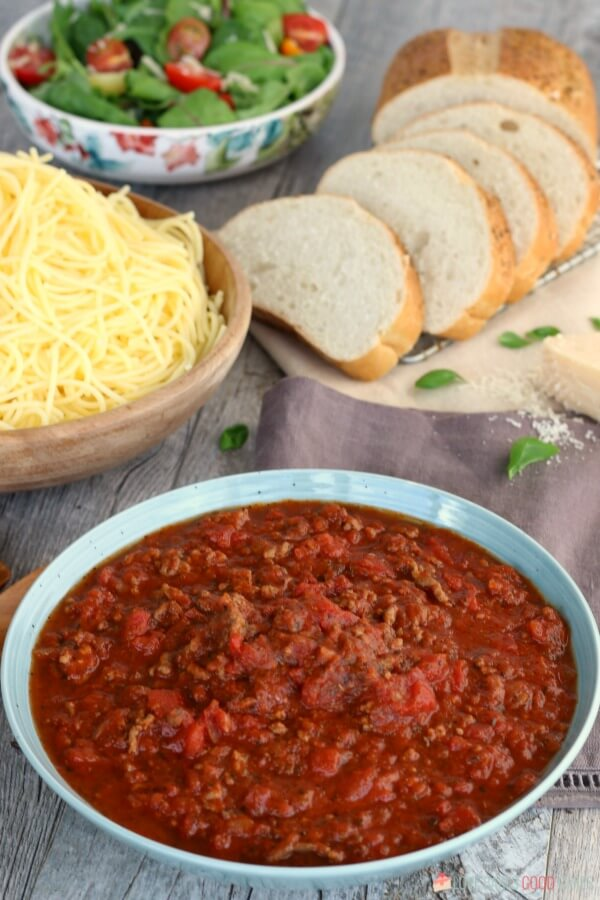 Slow Cooker Spaghetti Sauce and pasta with bread slices and a green salad.