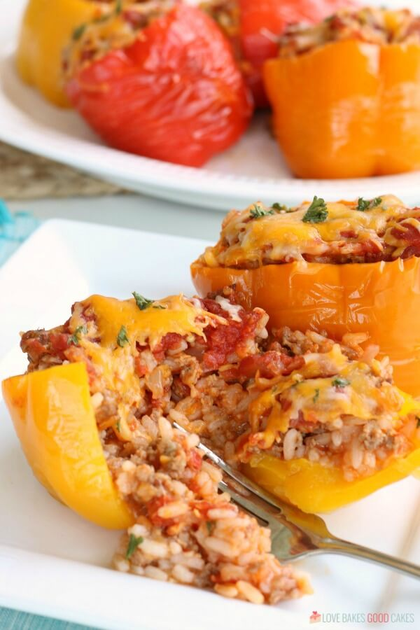 Stuffed bell peppers with rice, ground beef or sausage, tomato sauce and seasonings. These easy stuffed peppers are a tasty dinner.