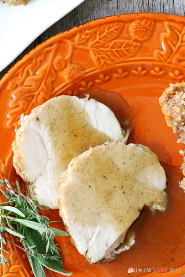 Instant Pot Turkey Breast on a plate with gravy.