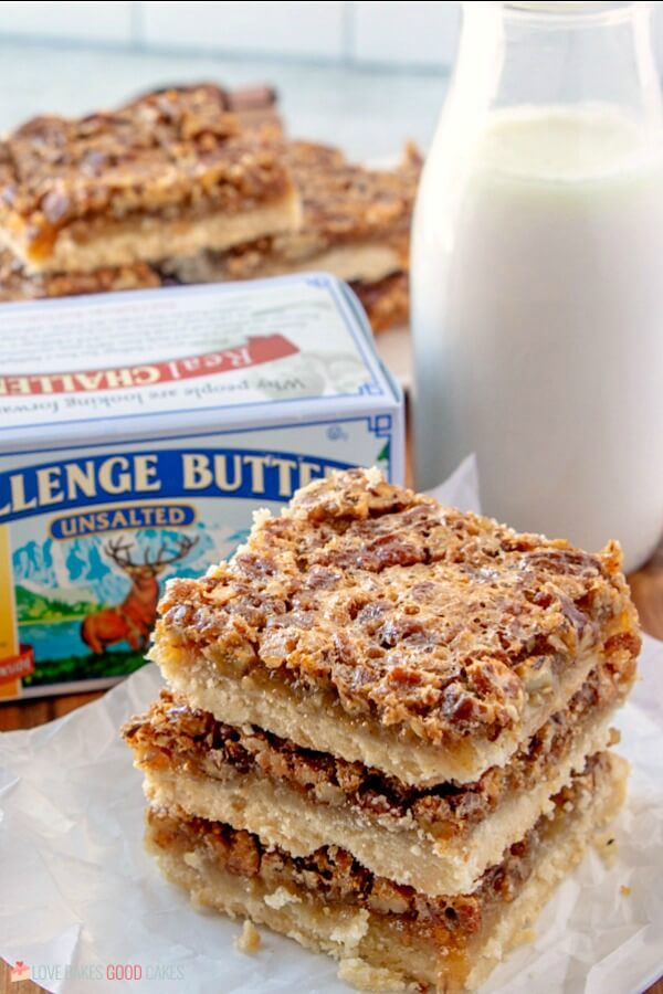 finished Pecan Pie Bars with glass of milk
