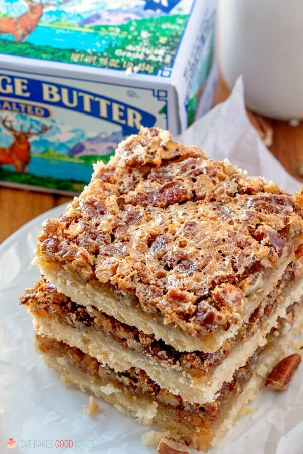 Pecan Pie Bars close up with a package of Challenge Butter