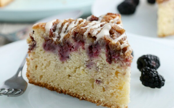 coffee cake on plate with berries and fork