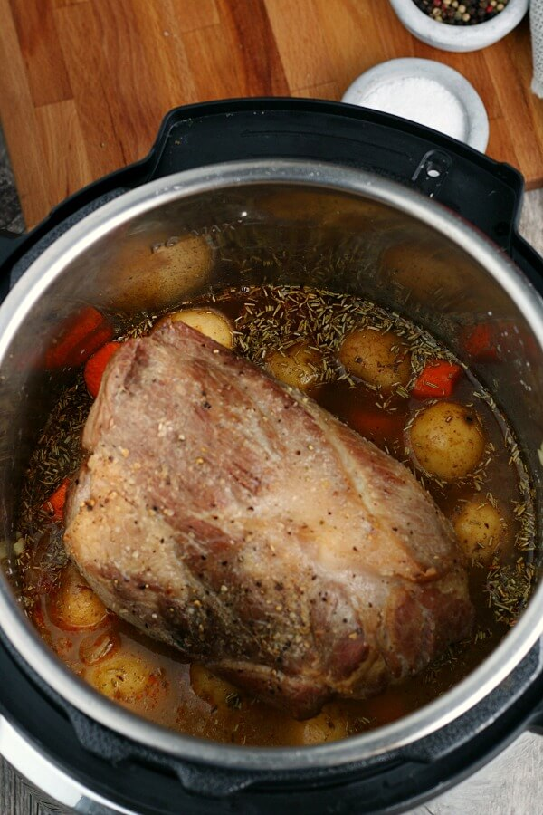 The pork loin roast cooks with lots of veggies and potatoes for a complete meal in one pot!