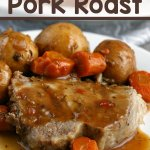 pork roast with potatoes, carrots and gravy on plate