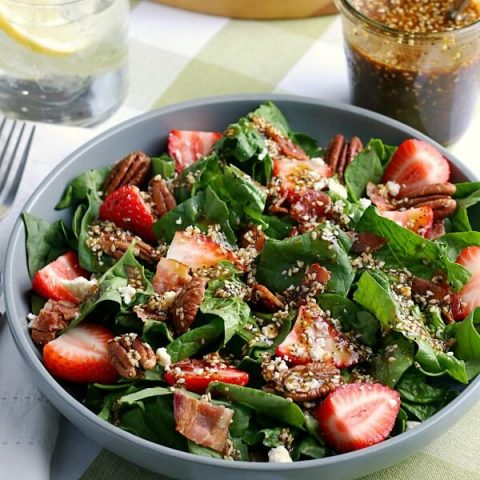 closeup of finished strawberry spinach salad