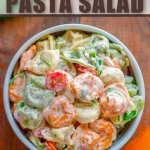 tortellini pasta salad in bowl on wooden background