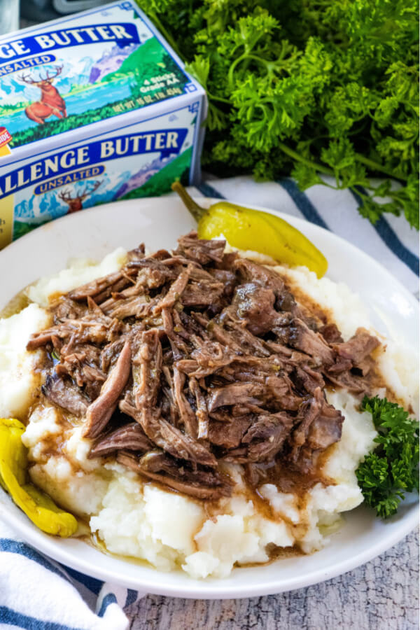 mississippi pot roast with gravy over mashed potatoes