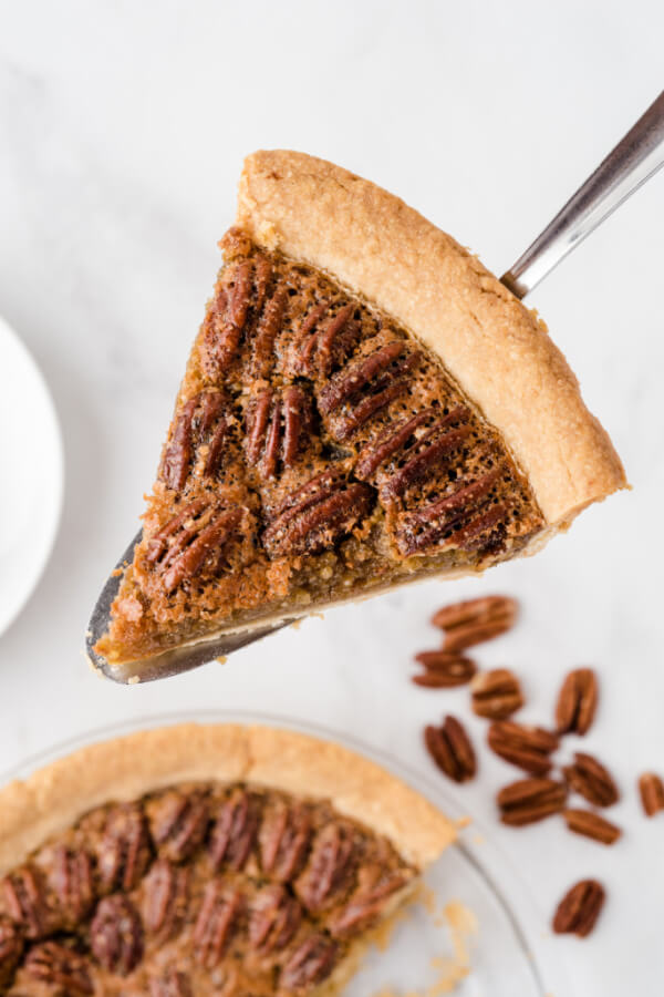slice of maple pecan pie on pie server