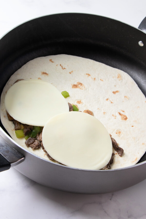 cooking the quesadilla in the pan