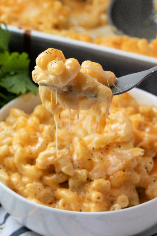 a bite of mac and cheese on fork