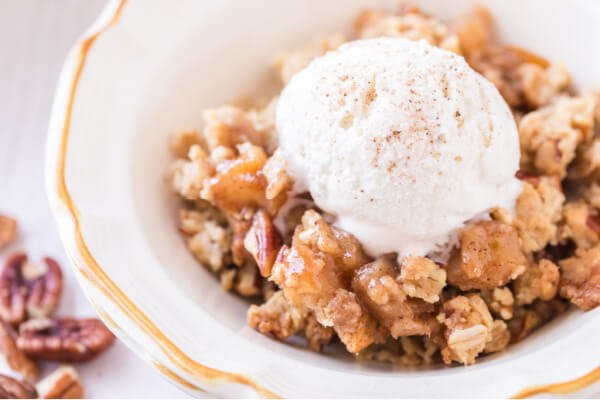 bowl of apple crumble with scoop of ice cream