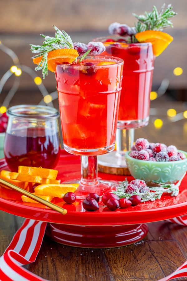 drinks on red cake stand with festive decor